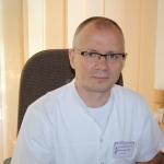 Dr Sławomir Okła